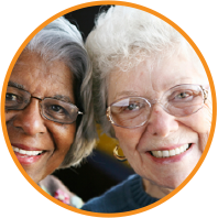 A picture of two women smiling, they are both wearing glasses